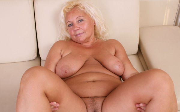 Blonde big granny posing naked