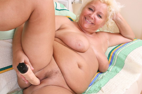 Fat granny plays with rubber dick